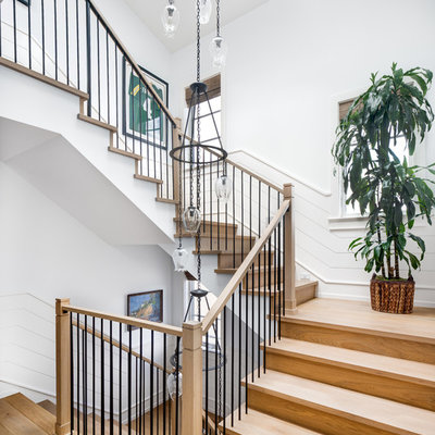 Staircase - coastal wooden u-shaped mixed material railing staircase idea in Los Angeles with wooden risers