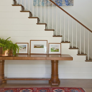 Example of a trendy wooden staircase design in Boston