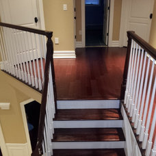 Traditional Staircase by A&E RENOVATIONS