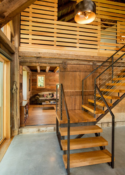 Farmhouse Staircase by Silver Maple Construction LLC