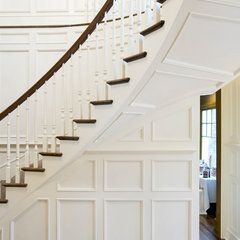 traditional staircase by Akke Woodworks