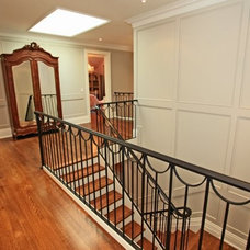 Traditional Staircase by Foremost Construction Inc