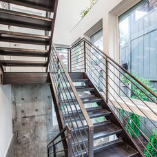 Contemporary Staircase by Dale Tu Photography