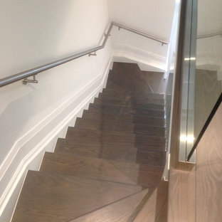 Staircase - mid-sized modern wooden l-shaped staircase idea in Toronto with glass risers