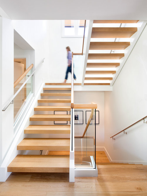Inspiration For A Mid Sized Scandinavian Wooden U Shaped Open Staircase  Remodel In Vancouver