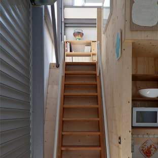 Inspiration for an industrial wooden straight open staircase remodel in London
