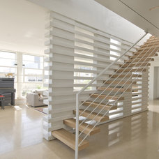 Modern Staircase by Amitzi Architects