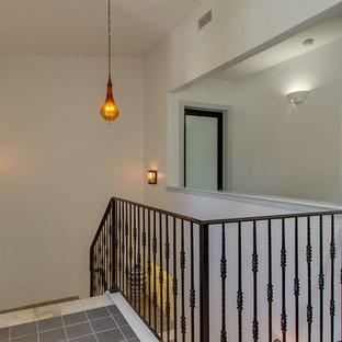 Идея дизайна: угловая лестница среднего размера в стиле рустика с ступенями из плитки и подступенками из плитки