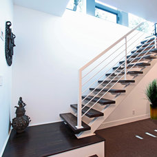 Contemporary Staircase by Anthony Wilder Design/Build, Inc.