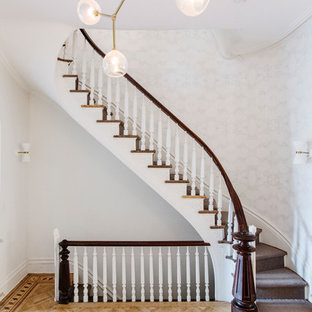 Staircase - transitional wooden curved wood railing staircase idea in New York with wooden risers