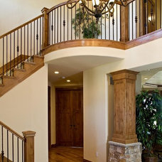 Traditional Staircase by Archevie Design