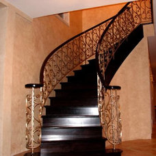 Traditional Staircase by architectural traditional  metal  iron work