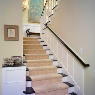 Inspiration for a mid-sized timeless wooden u-shaped staircase remodel in Los Angeles with painted risers