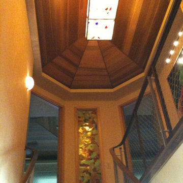 Art Glass Stairwell in Casually Elegant Sugar Cove Remodel