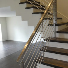 Contemporary Staircase by ARTACO Railing Systems