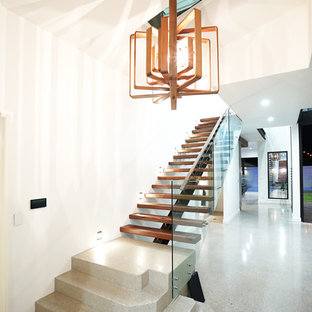 This is an example of a contemporary wood straight staircase in Brisbane with open risers.