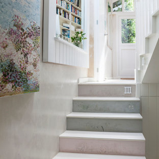 Cottage chic staircase photo in London