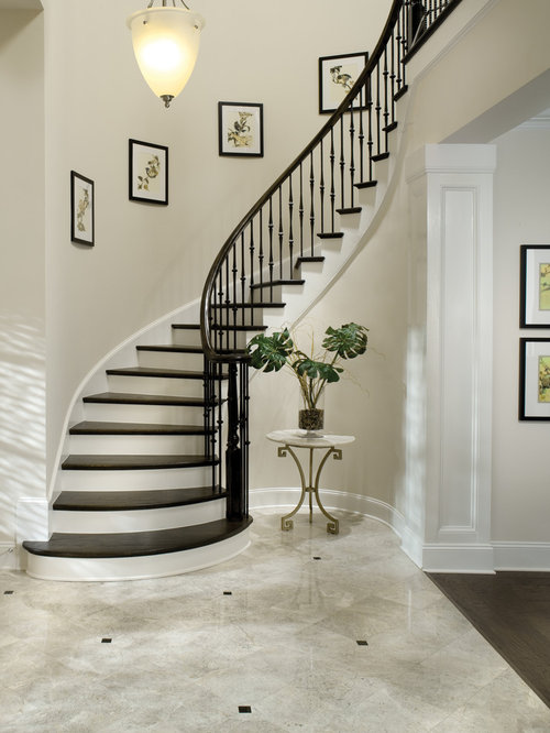 elegant wooden curved metal railing staircase photo in tampa