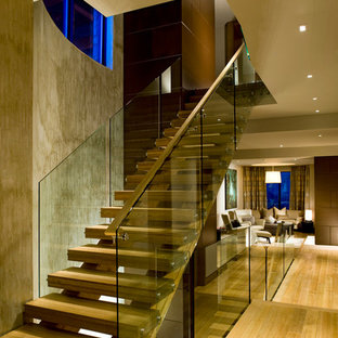 Example of an asian staircase design in Denver