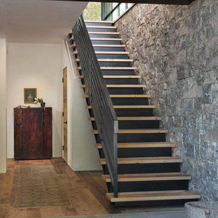 Inspiration for a rustic staircase remodel in Other