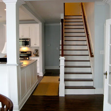Traditional Staircase by Athens Building Company
