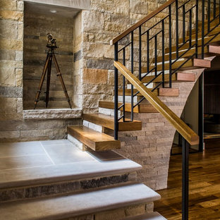 Example of a country wooden floating mixed material railing staircase design in Atlanta
