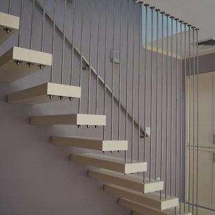 Example of a mid-sized transitional acrylic floating staircase design in Boston