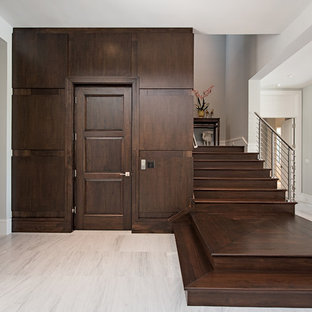 Inspiration for a transitional wooden l-shaped cable railing staircase remodel in Miami with wooden risers