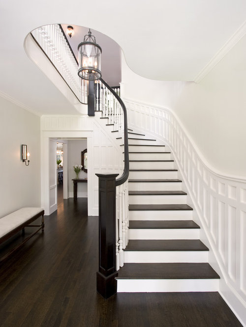 Example Of A Large Clic Wooden Curved Wood Railing Staircase Design In New York