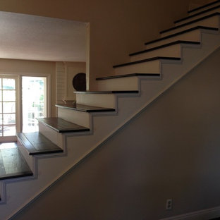 Staircase - mid-sized traditional painted straight staircase idea in Orange County with painted risers