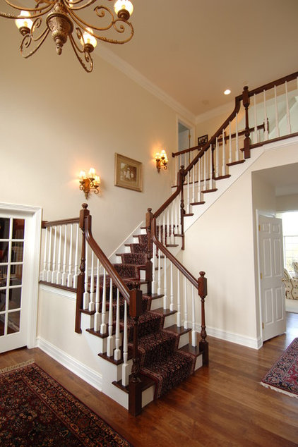 Traditional Staircase by Barenz Builders