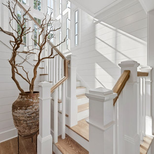 Wood wood railing staircase in Miami with painted wood risers.