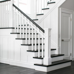 Example of a mid-sized coastal wooden u-shaped staircase design in Orange County with painted risers