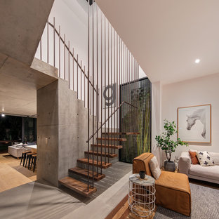 Inspiration for a contemporary wood u-shaped staircase in Sydney with open risers and metal railing.