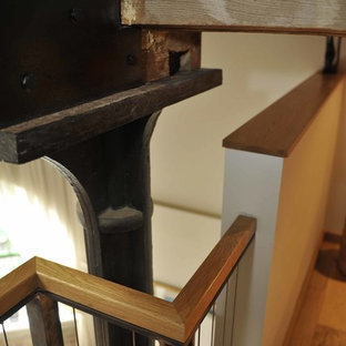 Design ideas for a medium sized contemporary wood straight staircase in London with open risers.