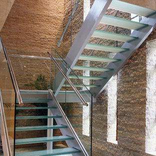 Contemporary glass u-shaped staircase in Cornwall with open risers.