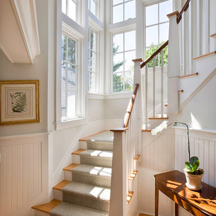 Design ideas for a large victorian wood curved staircase in Boston with painted wood risers.