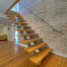 Modern Staircase by Moss Building and Design