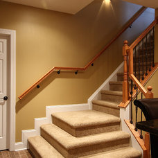 Traditional Staircase by NVS Remodeling & Design