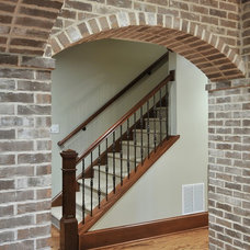 Traditional Staircase by Innovative Construction Inc.