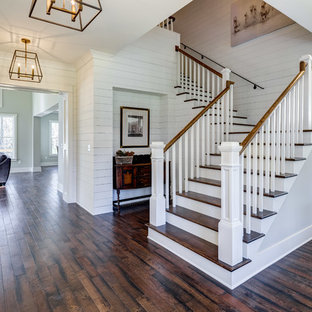 Photo of a transitional wood l-shaped staircase in Atlanta with painted wood risers.