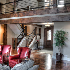 Rustic Staircase by Big Wood Timber Frames, Inc.