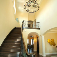 Mediterranean Staircase by Devonshire Custom Homes
