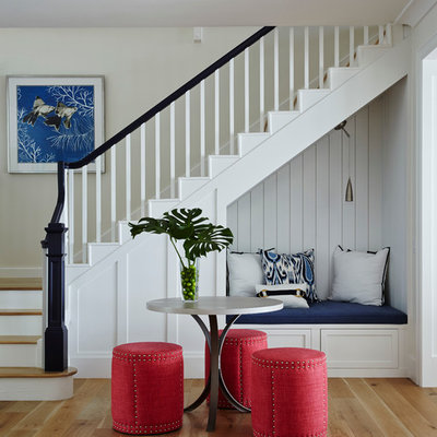 Example of a mid-sized beach style wooden l-shaped staircase design in San Diego with painted risers