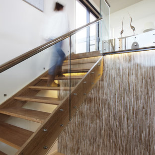 Coastal wooden straight open and glass railing staircase photo in Melbourne