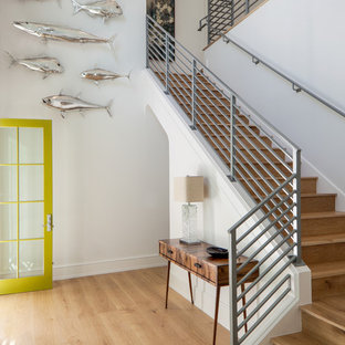 Coastal wooden l-shaped metal railing staircase photo in Miami with wooden risers