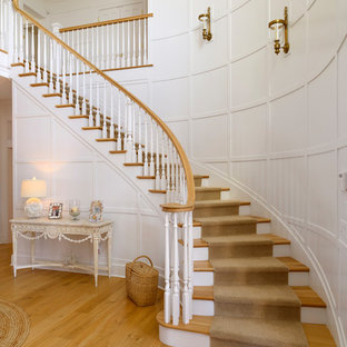 Inspiration for a coastal wooden curved wood railing staircase remodel in New York with wooden risers