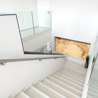 Staircase - mid-sized modern u-shaped staircase idea in Other with glass risers