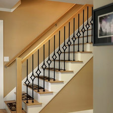 traditional staircase by Tom Curren Companies