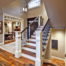 Traditional Staircase by DESIGN GUILD HOMES